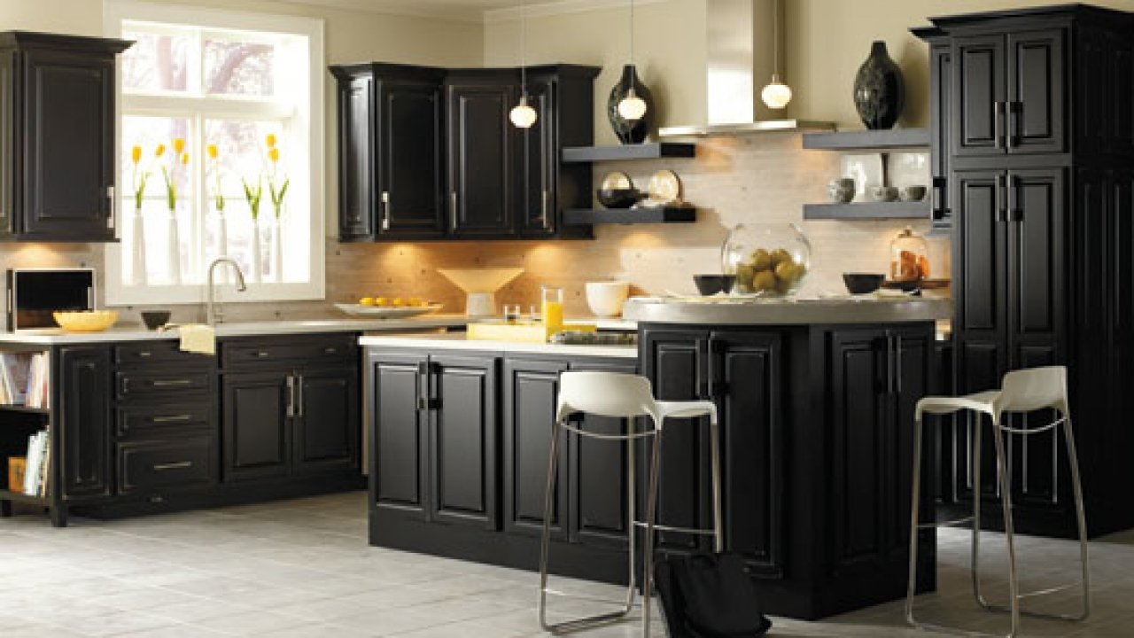Black kitchen cabinet knobs home furniture design for Images of black kitchen cabinets