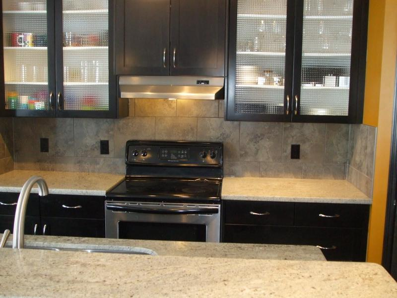 Black kitchen cabinets with glass doors home furniture for Black kitchen cabinet doors