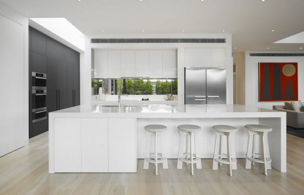 Modern white kitchen cabinets home furniture design for Modern house kitchen