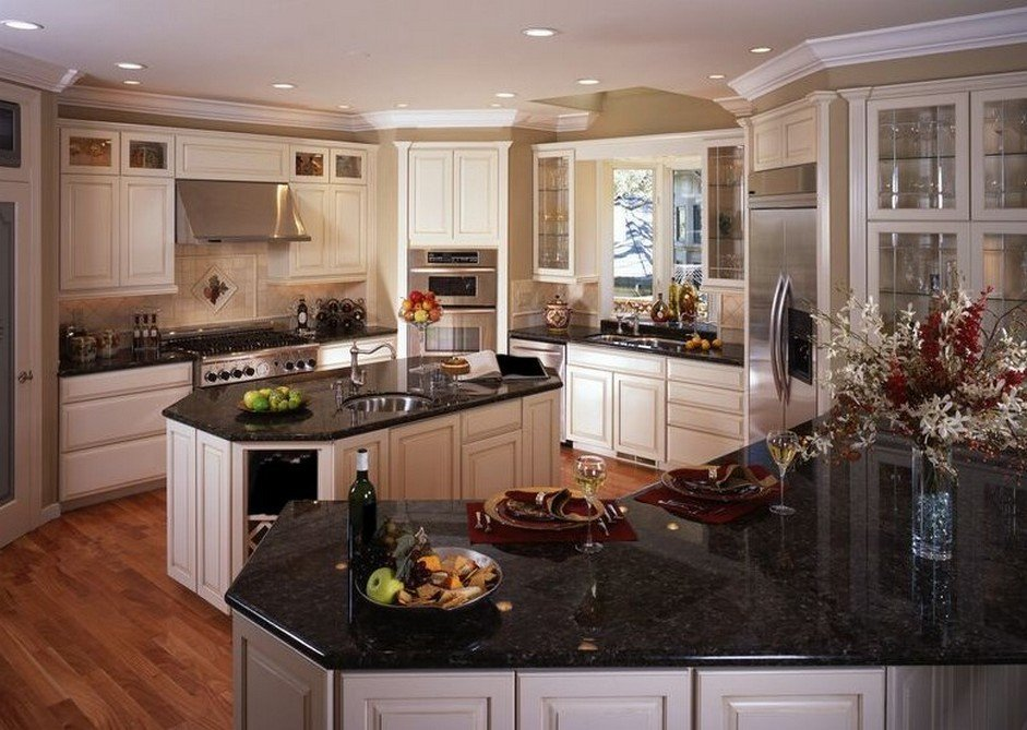 White kitchen cabinets with black granite for Black kitchen cabinets with white marble countertops