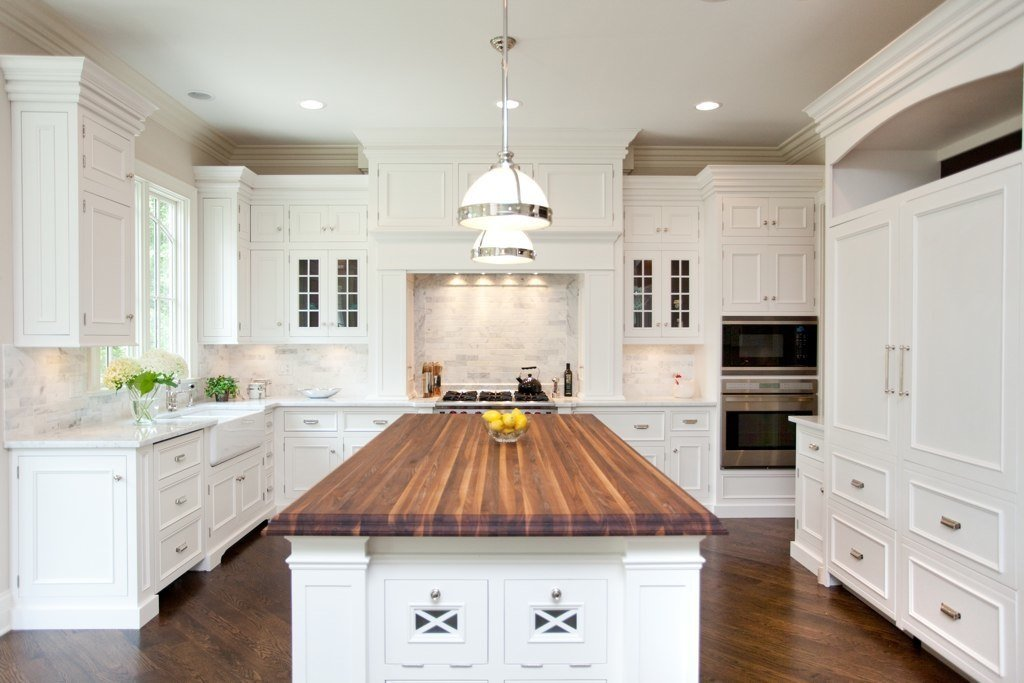 White kitchen cabinets with butcher block countertops for Kitchen counter cabinet
