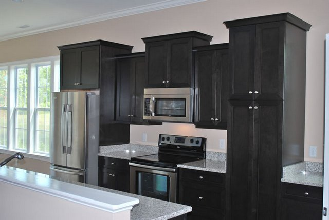 Ebony stained kitchen cabinets for Black stained cabinets