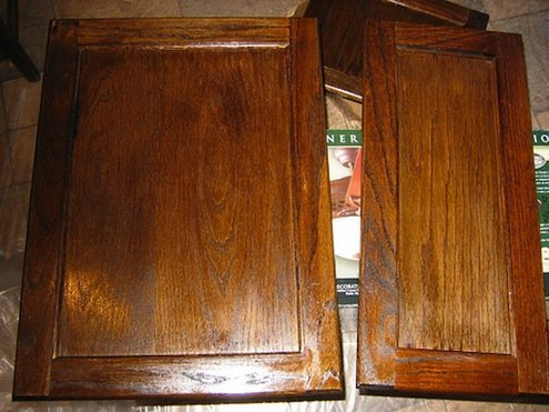 How to refinish kitchen cabinets with stain home for Can you paint non wood kitchen cabinets
