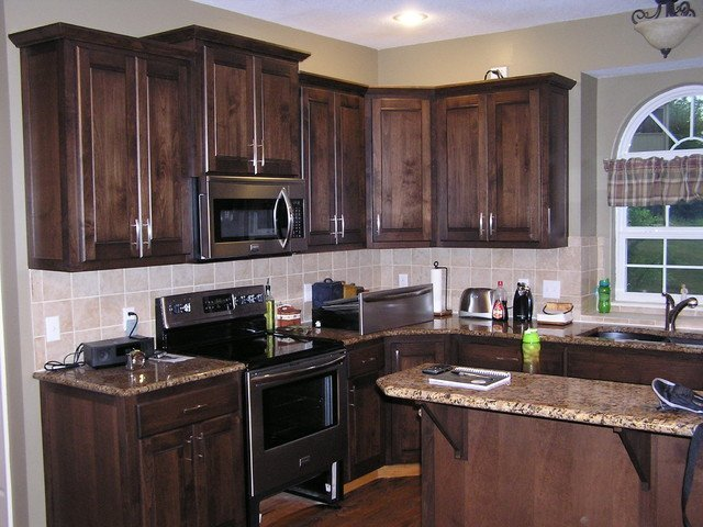 How to stain kitchen cabinets home furniture design for Can you paint non wood kitchen cabinets