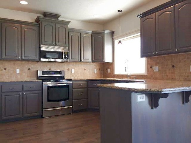 Stain kitchen cabinets home furniture design for Can you paint non wood kitchen cabinets