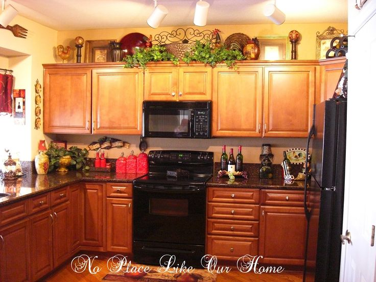 Decorating ideas for top of kitchen cabinets home for Above cupboard decoration ideas