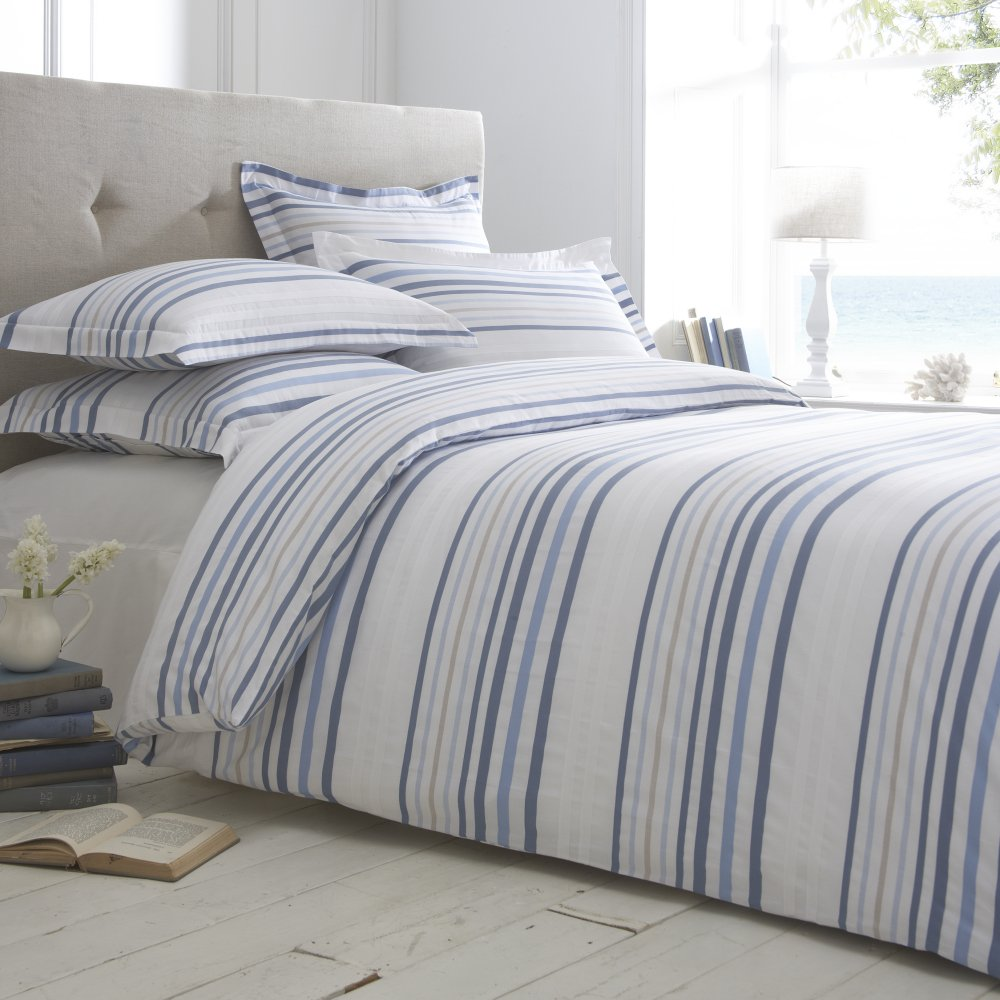 Capture the casual sophistication of coastal style with our Aldon Stripe duvet cover and shams. Made from % soft washed linen, its wide cabana-stripe pattern in denim blue and ivory and button closure detail offer a fresh, classic look that complements many styles.