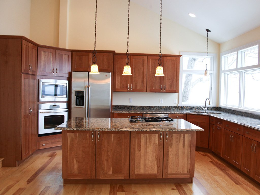 Light cherry kitchen cabinets home furniture design for Pictures of kitchen cupboards