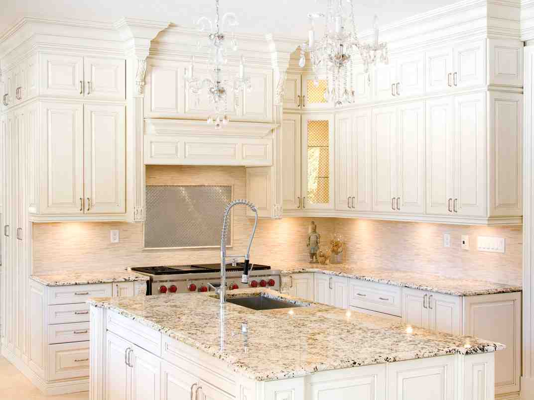 Huge Kitchen With White Cabinets With White Quartz Countertops